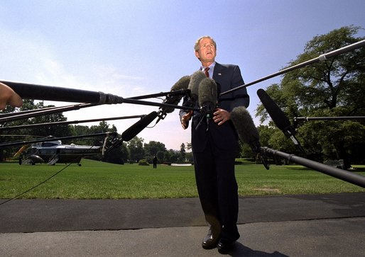 President George W. Bush speaks to the media before departing the White House Friday afternoon, August 2, 2002. White House photo by Eric Draper.