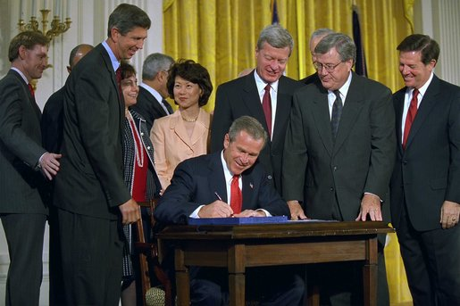 "President George W. Bush signs the Trade Act of 2002 in the East Room Tuesday, Aug. 6. ""With trade promotion authority, the trade agreements I negotiate will have an up-or-down vote in Congress, giving other countries the confidence to negotiate with us,"" said the President in his remarks. White House photo by Tina Hager."