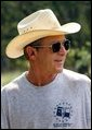 President George W. Bush takes a break during work at his ranch in Crawford, Texas, Friday, Aug. 9, 2002. White House photo by Eric Draper.