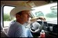 President George W. Bush drives his pickup truck at his ranch in Crawford, Texas, Friday, Aug. 9, 2002. White House photo by Eric Draper.