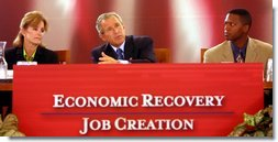 President George W. Bush address panelists at the Economic Recovery and Job Creation discussion panel at the President's Economic Forum held at Baylor University in Waco, Texas on Tuesday August 13, 2002. White House photo by Paul Morse.