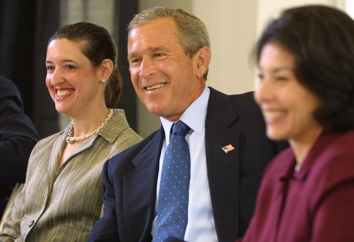 President George W. Bush listens to a suggestion with panelists Carmen Agiuar, left, and Delia Garcia at the Corporate Responsibility discussion panel at the President's Economic Forum held at Baylor University in Waco, Texas on Tuesday August 13, 2002.