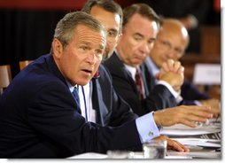 President George W. Bush talks to panelists during a drop-by of the discussion panel on Healthcare Security at the President's Economic Forum held at Baylor University in Waco, Texas on Tuesday August 13, 2002. White House photo by Paul Morse.