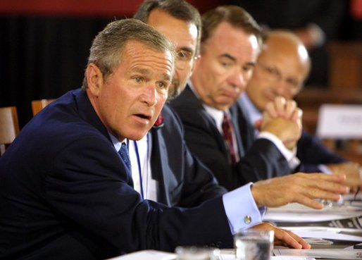 President George W. Bush talks to panelists during a drop-by of the discussion panel on Healthcare Security at the President's Economic Forum held at Baylor University in Waco, Texas on Tuesday August 13, 2002.