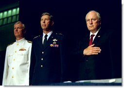 Vice President Dick Cheney Vice stands at attention with Vice Admiral John Totushek, left, and General Donald Cook, center, during the National Anthem moments before addressing veterans of the Korean War in San Antonio, TX Aug. 29, 2002. White House photo by David Bohrer.