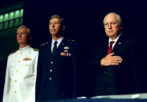 Vice President Dick Cheney Vice stands at attention with Vice Admiral John Totushek, left, and General Donald Cook, center, during the National Anthem moments before addressing veterans of the Korean War in San Antonio, TX Aug. 29, 2002.