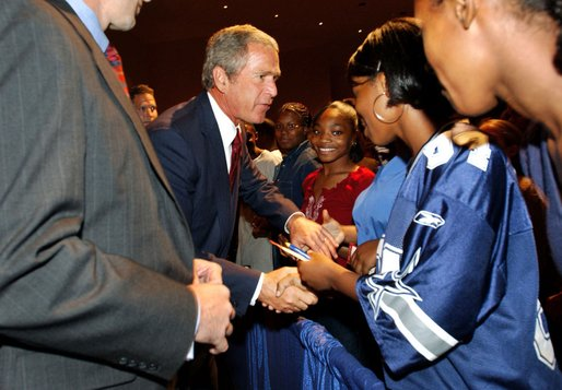 President George W. Bush greets students after remarks at Parkview Arts and Science Magnet High School in Little Rock, Arkansas, Thursday, Aug. 29.