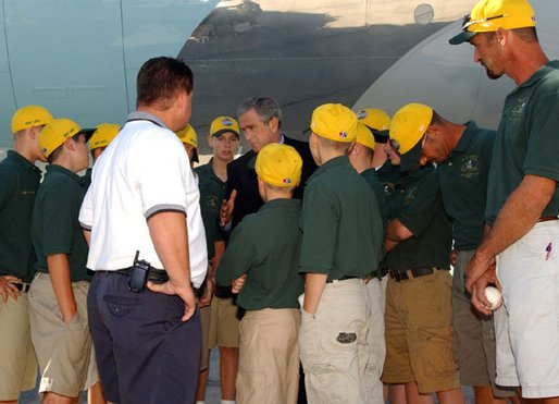 President George W. Bush greets players and coaches from the Valley Sports American Little League, this year's Little League World Series Champions, upon arrival at Louisville International Stanford Field Airport in Kentucky Thursday, September 5, 2002.
