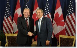President George W. Bush and Canadian Prime Minister Jean Chretien address the media before their bilateral meeting in Detroit Monday, September 9. White House photo by Paul Morse.