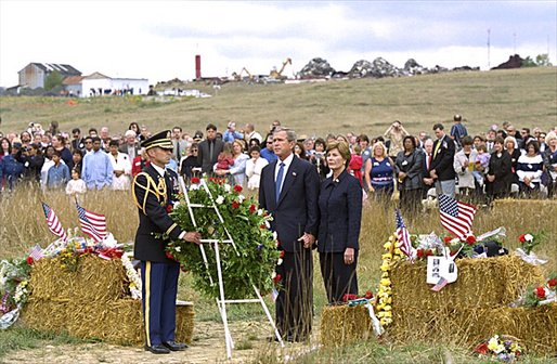 President George W. Bush and Mrs. Laura Bush participate in a wreath-laying ceremony near the site of the crash where seven crew members and 33 passengers died when the plane crashed in Somerset County. Officials believe the plane was heading for a target in Washington, D.C., when the passengers fought back against the four hijackers. White House photo by Tina Hager.