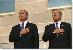 Attending the Pentagon Observance ceremony, President George W. Bush and Secretary of Defense Donald Rumsfeld say the Pledge of Allegiance before speaking Tuesday, Sept. 11. White House photo by Eric Draper.