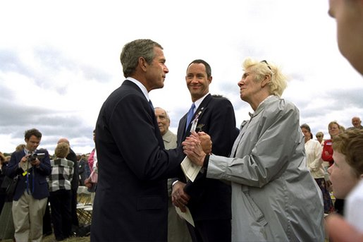 President George W. Bush talks to relatives of the victims from Flight 93 after laying a wreath at the crash site in Somerset County Pennsylvania on September 11, 2002. White House photo by Eric Draper.
