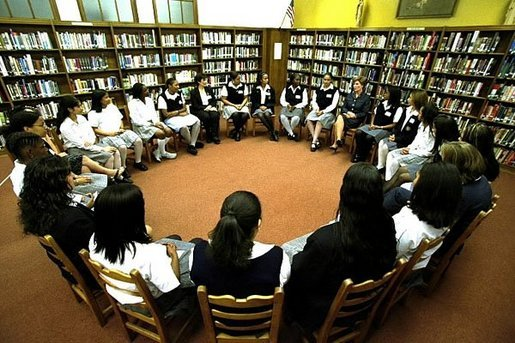 Mrs.Bush talks with students during a roundtable discussion at the Saint Thomas Aquinas High School in the Bronx, New York City, Sept. 12, 2002. White House photo by Susan Sterner.
