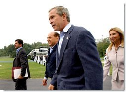 Flanked by interpreters, President George W. Bush and Italian Prime Minister Silvio Berlusconi leave a news conference after Berlusconi's arrival at Camp David, Saturday, Sept. 14, 2002. WHITE HOUSE PHOTO BY ERIC DRAPER White House photo by Eric Draper.