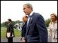 Flanked by interpreters, President George W. Bush and Italian Prime Minister Silvio Berlusconi leave a news conference after Berlusconi's arrival at Camp David, Saturday, Sept. 14, 2002. WHITE HOUSE PHOTO BY ERIC DRAPER