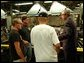 President George W. Bush tours the Sears Manufacturing Company in Davenport , Iowa on Monday, September 16, 2002.