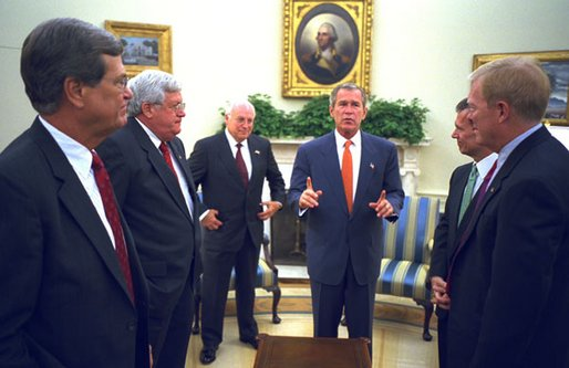 President George W. Bush along with Vice President Dick Cheney talk with Congressional Leaders Wednesday, Sept. 18, 2002, in the Oval Office. White House photo by Eric Draper.