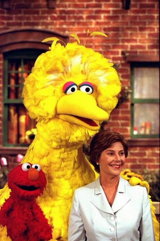 Big Bird and Elmo pose with Mrs. Bush on the set of Sesame Street in New York following a taping honoring the famous children's show, Sept. 19, 2002. White House photo by Susan Sterner
