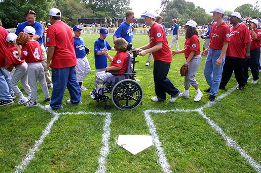 T-Ball teams from East Brunswick New Jersey Babe Ruth Buddy Ball League Sluggers in red and the Waynesboro Little League Challenger Division Sand Gnats in blue from Waynesboro, Virginia congratulate each other after playing Sunday September 22, 2002 on the South Lawn of the White House. White House photo by Paul Morse.