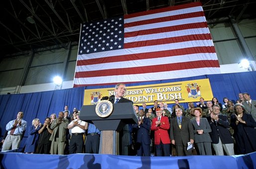 President George W. Bush addresses service personnel and guests at the Army National Guard Aviation Support Facility in Trenton, New Jersey, Monday, Sept. 23.