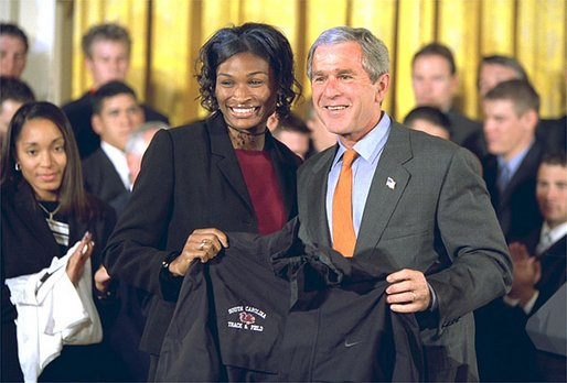 President George W. Bush receives a jersey from the captain of University of South Carolina Women's Track & Field team at the White House Tuesday, Sept. 24. White House photo by Paul Morse.