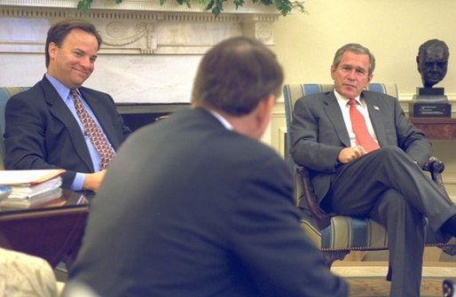President George W. Bush and Dr. Mark McClellan (left) listen to Tommy Thompson, Secretary of Health and Human Services, during a meeting in the Oval Office Wednesday, September 25, 2002. During the meeting President Bush announced Dr. McClellan, as nominee to be Commissioner of the Food and Drug Administration. Dr. McClellan is currently a member of the President's Council on Economic Advisors, and he also serves as a senior policy director for health care and related economic issues for the White House. White House photo by Tina Hager.