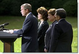 "President George W. Bush discusses his decision to seek an injunction under the Taft-Hartley Act to stops the lockouts of America's western ports during a press conference on the South Lawn of the White House Tuesday, Oct. 8. Accompanying the President is Secretaries Elaine Chao, left, Ann Veneman, center, and Norm Mineta. ""Americans are working hard every day to bring our economy back from recession,"" said the President. ""This nation simply cannot afford to have hundreds of billions of dollars a year in potential manufacturing and agricultural trade sitting idle.""."