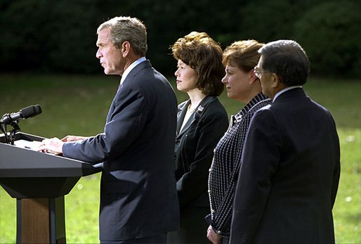 President George W. Bush discusses his decision to seek an injunction under the Taft-Hartley Act to stop the lockouts of America's western ports during a press conference on the South Lawn of the White House Tuesday, Oct. 8. Accompanying the President is Secretaries Elaine Chao, left, Ann Veneman, center, and Norm Mineta. White House photo by Tina Hager.