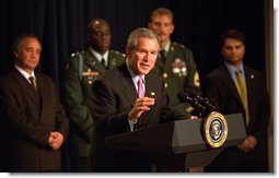 "President George W. Bush highlights humanitarian efforts in Afghanistan during remarks about U.S. Humanitarian Aid to Afghanistan, Friday, October 11, 2002 at the Presidential Hall in the Dwight David Eisenhower Executive Office Building. ""More than 2 million Afghan refugees have returned back to the country since November. That is a positive sign. It's a good sign that people are sensing their country is a better place to live and more secure, a better place to raise a family,"" President Bush said. White House photo by Tina Hager."