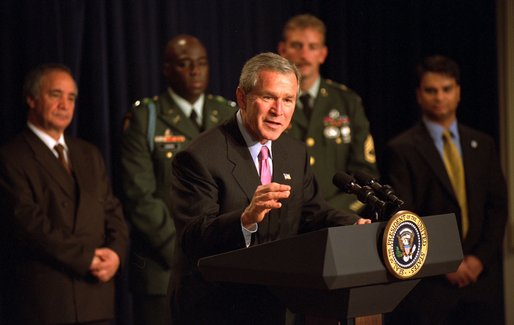 President George W. Bush highlights humanitarian efforts in Afghanistan during remarks about U.S. Humanitarian Aid to Afghanistan, Friday, October 11, 2002 at the Presidential Hall in the Eisenhower Executive Office Building. White House photo by Tina Hager.