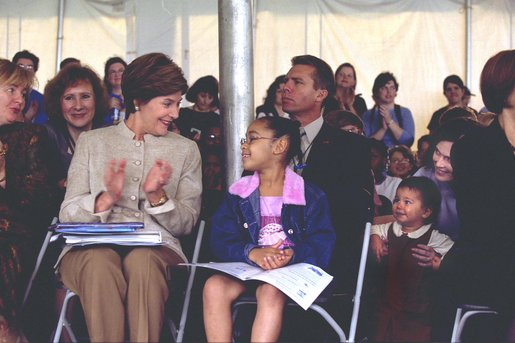 Laura Bush applauds at the end of a reading by renowned children's author and illustrator, Eric Carle Saturday, October 12, 2002 at the Second Annual National Book Festival on the held on the west side of the Capitol. White House photo by Susan Sterner.
