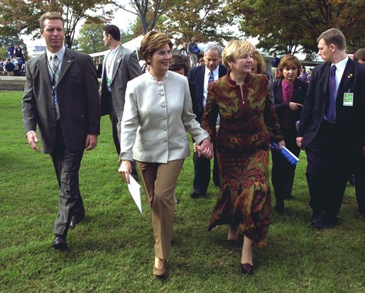 Laura Bush and Ludmila Putina, wife of Russian Federation President Vladimir Putin, stroll across the lawn of the Capitol visiting the tents of authors and story tellers at the Second Annual National Book Festival Saturday, October 12, 2002. White House photo by Susan Sterner.