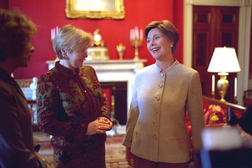 Laura Bush shares a light moment with Ludmila Putina, wife of Russian Federation President Vladimir Putin, in the Red Room of the White House Saturday, October 12, 2002 prior to the opening ceremony of the Second Annual National Book Festival. White House photo by Susan Sterner.