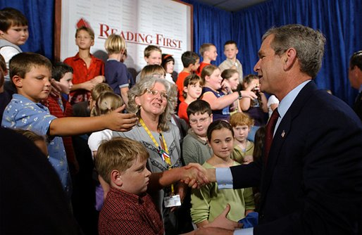 President George W. Bush greets students and teachers after delivering remarks on education at Read-Patillo Elementary School in New Smyrna Beach, Fla., Thursday, Oct. 17. White House photo by Eric Draper. White House photo by Eric Draper.