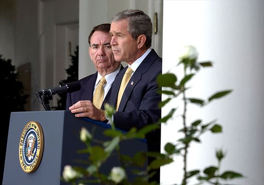 "President George W. Bush announces the administration's new rule on generic drugs in the Rose Garden Monday, Oct. 21. Standing with the President is Secretary of Health and Human Services Tommy Thompson. ""By this action, we will reduce the cost of prescription drugs in America by billions of dollars and ease a financial burden for many citizens, especially our seniors,"" explained the President. White House photo by Tina Hager."