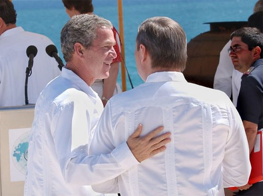 President George W. Bush walks with Russian Prime Minister Mikhail Mikhaylovich Kasyanov before the start of the Reading of the Leaders' Declaration at APEC in Los Cabos, Mexico, Sunday, Oct. 27. White House photo by Tina Hager.