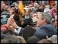 President George W. Bush greets the crowd after speaking at the New Mexico Welcome at Riner Steinhoff Soccer Complex in Alamogordo, N.M., Oct. 28.