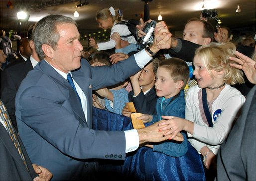 President George W. Bush greets audience members after speaking during the Colorado Welcome at the Wings Over The Rockies Air and Space Museum in Denver, Colo., Monday, Oct. 28.