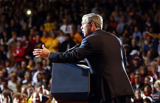 Welcomed by a crowd of more than 4000 people, President George W. Bush addresses the cheering audience at Northern State University in Aberdeen, S.D., Oct. 31. White House photo by Tina Hager.