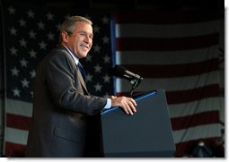 President George W. Bush reacts to the crowd during the Tennessee Welcome at the Tri-City Aviation in Blountville, Tennessee, Saturday, Nov.2, 2002.  White House photo by Eric Draper