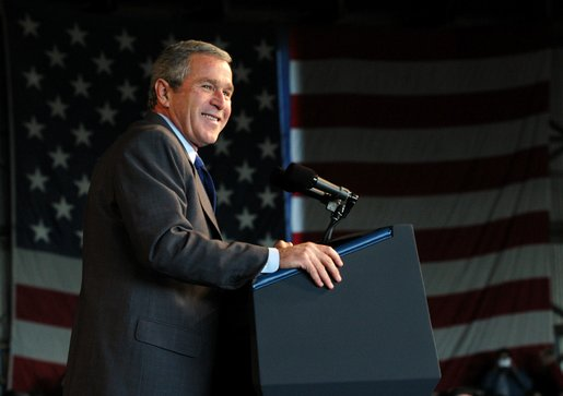 President George W. Bush reacts to the crowd during the Tennessee Welcome at the Tri-City Aviation in Blountville, Tennessee, Saturday, Nov.2, 2002. White House photo by Eric Draper.