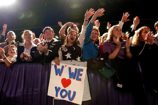 The audience reacts during the introduction of President George W. Bush during the Atlanta, Georgia Welcome at the Cobb Galleria Centre, Saturday, Nov. 2, 2002. White House photo by Eric Draper.