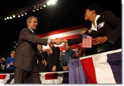President George W. Bush greets stage participants during the Atlanta, Georgia Welcome at the Cobb Galleria Centre, Saturday, Nov. 2, 2002.   White House photo by Eric Draper