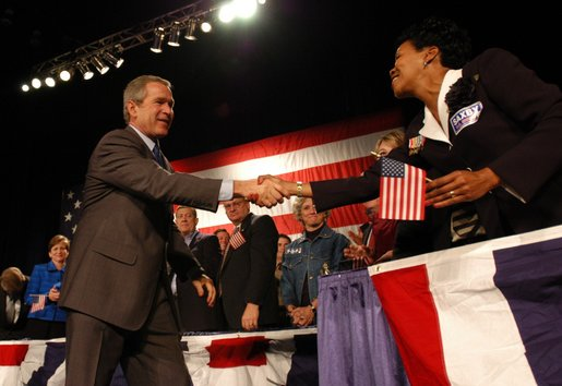 President George W. Bush greets stage participants during the Atlanta, Georgia Welcome at the Cobb Galleria Centre, Saturday, Nov. 2, 2002. White House photo by Eric Draper.