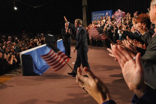 President George W. Bush acknowledges the crowd during his introduction at the Illinois Welcome at the Illinois Police Armory in Springfield, Illinois, Sunday, Nov. 3, 2002 White House photo by Eric Draper.