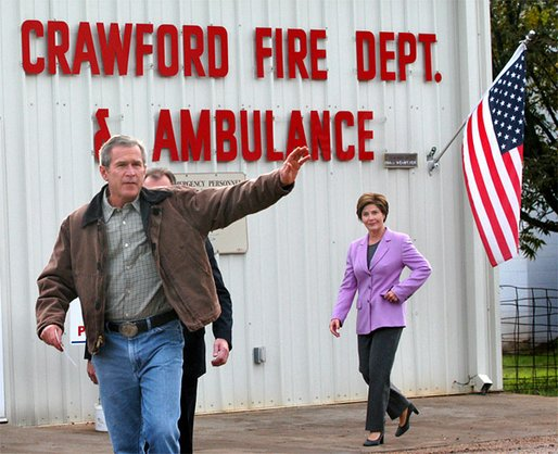 President George W. Bush and Laura Bush leave the Crawford Firehouse after voting in Crawford, Texas, Tuesday, Nov. 5. White House photo by Eric Draper