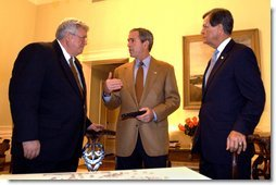 President George W. Bush talks with House Speaker Dennis Hastert and Senate Republican Leader Trent Lott while watching election returns in the White House residence Tuesday night, Nov. 5, 2002.  White House photo by Eric Draper