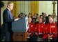 President George W. Bush makes remarks to American and British veterans ( seated in background) in the East Room of the White House on Veteran's Day, November 11, 2002 White House photo by Paul Morse