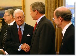"President George W. Bush greets former President Jimmy Carter during a photo opportunity in the Oval Office with the Nobel Laureates Monday, Nov.18. ""These Americans are a great honor to their fields and a great honor to our country. And we're proud to have you here. We're proud for what you've done, for not only America but the world. And we're proud for your contributions,"" said President Bush.  White House photo by Tina Hager"