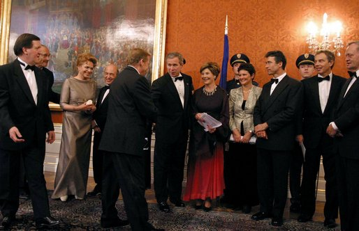 President George W. Bush and Mrs. Bush congratulate Czech Republic President Vaclav Havel during a gift presentation before a dinner for NATO leaders at Prague Castle in Prague, Czech Republic, Nov. 20. White House photo by Paul Morse